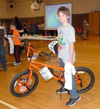 New bike owner Jaeden Parker was the lucky winner in a LEMS safety essay contest.
