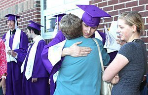 BHS senior Sam Bolton shares one of many hugs given in the graduation receiving line. Photo courtesy Burlingame High School.