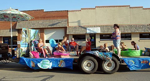 Local 4-Hers' first-place float portrayed Beach Blanket Bingo. The parade's theme was Songs of Summer.