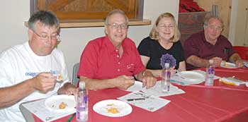 Pie judges always seem to be happy people. From left, Wayne White, Ray Hovestadt, Fran Richmond, and Ken Dubois.