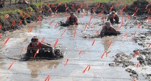 Mud pit and barbed wire.