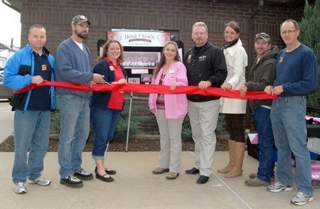 Welcoming Home Town Health Care LLC to Lyndon with a ribbon cutting ceremony Saturday were, from left, council member Chris Cole, Lyndon Mayor Brandon Smith, city administrator Kim Newman, Angie Sellers, RN, Jon Reed, director of operations, Juli Talkington, marketing, and council members Darby Kneisler and Bill Patterson.