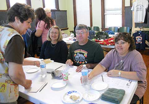 Pie contest organizer Frances Summers watches over lucky pie judges, from left, Fran Richmond, Wayne White, and Rose Hearn. Photo thanks to Brenda Wigger.