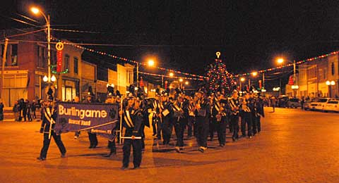 At a past Country Christmas, the Burlingame Bearcat Band joins the parade after performing during the downtown Christmas tree lighting.