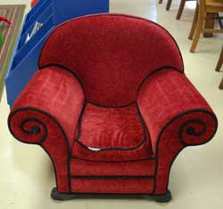 A special, comfortable reading chair is reserved for young readers only.
