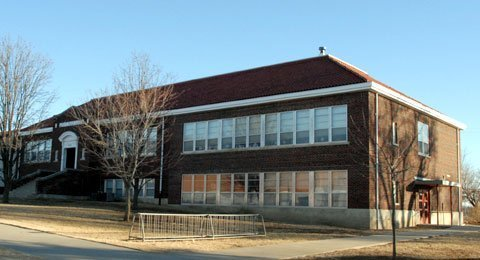 The original portion of Lyndon Elementary-Middle School would be demolished as part of a plan to build new facilities. Proposed to be built in the location of the old elementary school is a practice football field.