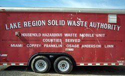 Drop off your HHW. Look for the red trailer.