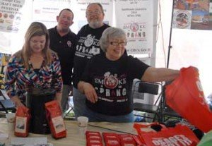 Osage City ambassadors, the Lohmeyers and Azwells, greet visitors at the 2014 Kansas Sampler Festival.