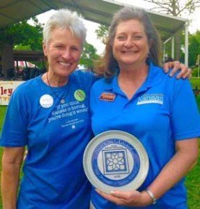 Marci Penner, left, presents a We Kan! Award plate to Sue Stringer.