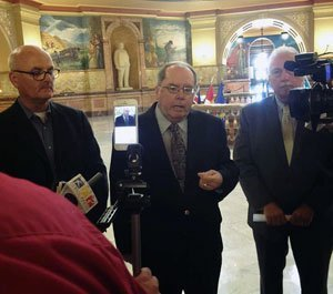 State Sen. Anthony Hensley, center, announces a petition drive to attempt to force the governor to call a special session.
