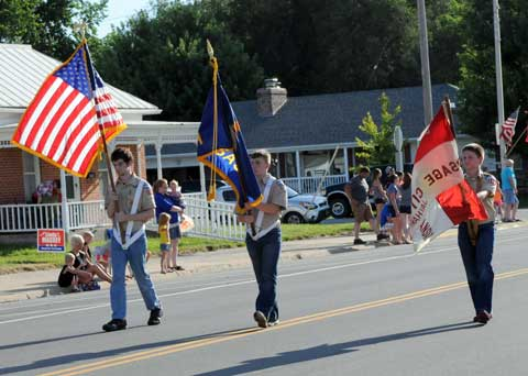 Local Boy Scouts guard the colors and lead the parade.