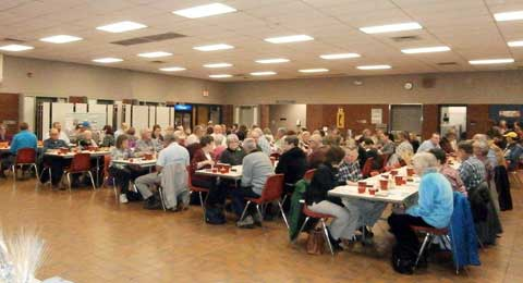 A capacity crowd gathered at Osage City school cafeteria for the conservation district's annual dinner.