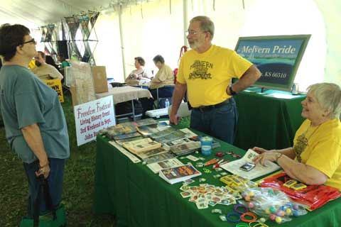 Melvern's Yocums talk to visitors at the Kansas Sampler Festival.