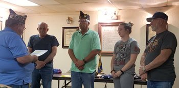 Past commander Bryce Romine, left, swears in new officers of American Legion Post 125, from left, Sergeant-at-Arms Lou Wohlitz, Commander Danny Roush, Adjutant and Finance Officer Geri Thomas, and Vice Commander Lou Ogle. Photo by Patrick Thomas.